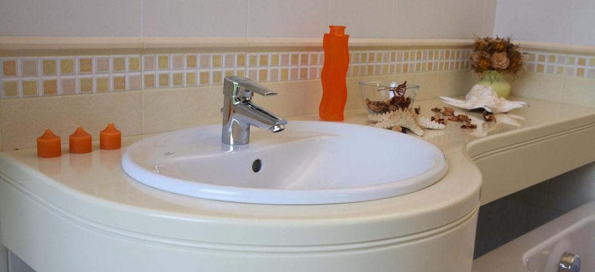 Ванные комнаты и мойки из акрилового камня